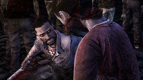 twd-ep-5-screenshot-lee-cuts-zombie-head-in-two